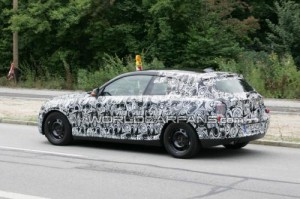 142392801263746277 300x199 2011 BMW 1 Series three door spied for first time low long and sleek