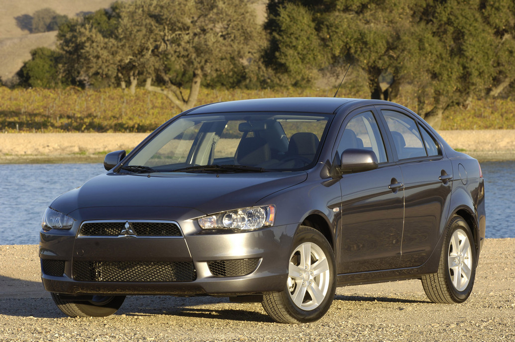 2011 mitsubishi lancer photos price specifications. Black Bedroom Furniture Sets. Home Design Ideas